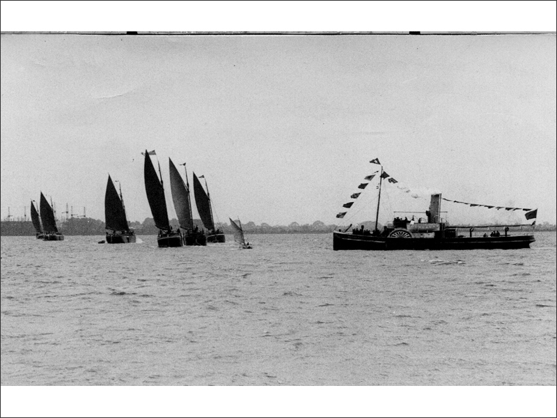 Vintage photo of some sloops and a paddle steamer